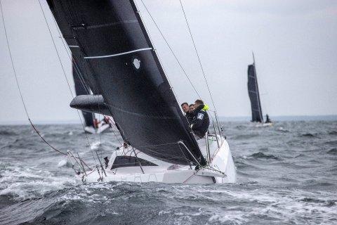 flying racing yachts at sea