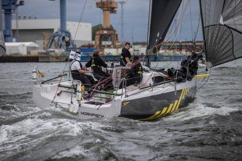 sailboat passing the mark